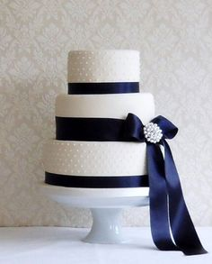 All cakes are filled and iced, include some simple decoration and are finished with a ribbon on an iced cake board. Tiers are stacked or separated as desired or displayed on a stand.