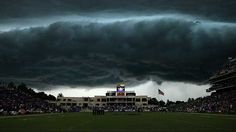Storm clouds looming In this Sept. 25, 2010 photo, a storm cloud looms over Bill Snyder Family stadium during the first quarter of an NCAA college football game against Central Florida in Manhattan, Kan. The game was suspended due to lightning in the area. (AP Photo/C