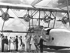 Passengers are seen boarding the same plane in 1932, dressed to the nines in honour of this new and staggering feat of engineering