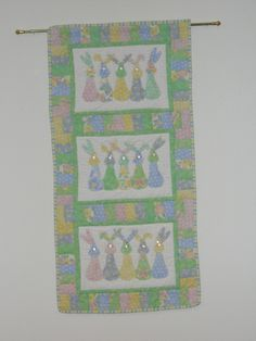 The Bunny Parade Wall Hanging I made for Union Central.  I used the left over fabric from the table runners so it all coordinates. The pattern can be found in McCall's QuickQuilts Magazine April/May 2011.  The pattern shows one set of bunnies.  I needed a larger wall hanging so continued the basic pattern by adding 2 more rectangles with 5 bunnies.