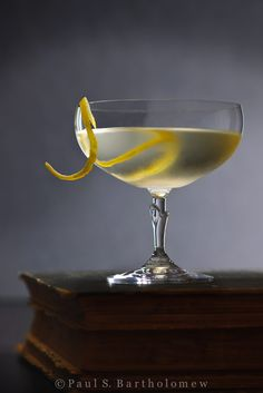 """The Vesper - as written by Ian Fleming for James Bond: """"Three measures of Gordon's, one of vodka, half a measure of Kina Lillet. Shake it very well until it's ice-cold, then add a large thin slice of lemon peel. Got it?"""" - Casino Royale, Chapter 7 3 oz of Gordon's Gin 1 oz of vodka .5 oz measure Kina Lillet lemon peel for garnish"""