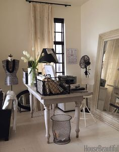 In a penthouse studio apartment overlooking Gramercy Park, designer Ellen O'Neill used a corner to serve as her office space. The farm table she uses as a desk is cleared off and used for a dining table when she entertains.   - HouseBeautiful.com