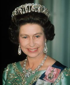 Queen Elizabeth II wearing the Grand Duchess Vladimir tiara. It has interchangeable emeralds and pearls.