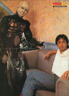 Pinhead and Clive Barker. Seriously, what is up with the background?? This really does look like it might be hell.