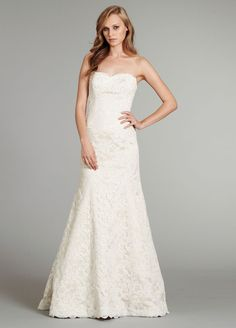 DESIGNER: Hayley Paige STYLE: Cricket NECKLINE: Sweetheart SILHOUETTE: Fit N' Flare FABRIC: Lace COLOR: Ivory FEATURES: Satin lining, lace scalloping along neckline TRAIN: Chapel CONDITION: No rips, tears, snags or stains. SIZE: 14 PRICE $1600.00