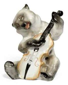 "A RUSSIAN PORCELAIN FIGURE, LOMONOSOV FACTURY, CIRCA MID 20TH CENTURY, MODELLED AS A BEAR CELLIST FROM KRYLOV'S ""THE QUARTET"""