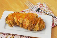 Scalloped Hasselback Potatoes (potatoes, butter, parmesan, garlic, salt, evoo, heavy cream, cheddar)