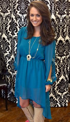 teal high low dress with cut out sleeves.