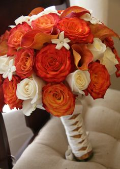 Orange and White bouquet. Roses, calla lilies, and stephanotis. Love the ribbon!