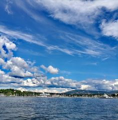 sky, architecture, cloud - sky, sea, built structure, building exterior, water, day, outdoors, waterfront, blue, no people, scenics, nature, town, beauty in nature, nautical vessel, harbor, tree, city, cityscape