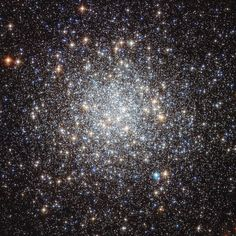 This image from the NASA/ESA Hubble Space Telescope shows the globular cluster Messier 9. Hubble's image resolves stars right into the centre of the cluster, and clearly shows they have different colours. Redder colours signify lower surface temperatures, while blue stars are extremely hot.