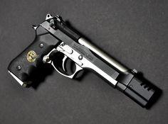 M9 Beretta custom with muzzle break.