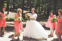 Coral is proving to be a color with major staying power for bridesmaids. These girls how it's done.  #brideside #realwedding #wedding #coral #orange #short #inspiration #bridesmaids  Surrounded by beauty this wedding takes your breath away | Brideside