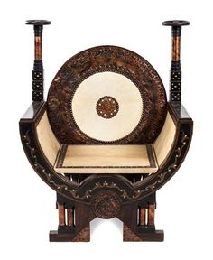 An Italian Carved and Inlaid Throne Chair Height 43 inches by Carlo Bugatti