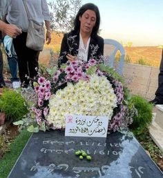 Palestinian heroine Khalida Jarrar was just released from israeli prison where she had been illegally detained for 2 years under administrative detention with no charges (other than not being Jewish of course). Her first stop was her daughter Suha's grave whom Khalida was forbidden to bury by the depraved regime of 'israel' when she passed two months ago. الله يرحمها 🙏🏼 #IsraeliCrimes Bury, Palestine, Prison, Israel, Floral Wreath, Daughter, Floral Crown, My Daughter, Daughters