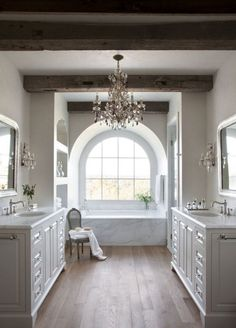 Light and airy. Without the chandelier- and make one sink side a vanity and have two sinks on one counter