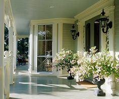I would love a big front porch and this one creates such a lovely entry.  Add some rocking chairs and a breakfast table and it's perfect! #countryliving #dreamporch