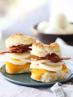Bacon Egg and Cheese Biscuit Sandwiches -- Hard boiled egg slices. That's a refreshing twist.