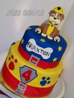 A bright and playful paw patrol cake. The bottom tier is chocolate with chocolate buttercream and covered in fondant. The top tier is caramel cake with caramel buttercream and covered in fondant. Rubble Paw Patrol Cake, Paw Patrol Cake Toppers, 2 Year Old Birthday Party, 2nd Birthday Party Themes, 4th Birthday, Birthday Cakes, Paw Patrol Birthday Cake, Paw Patrol Party, Mini Tortillas