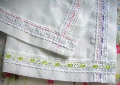 {sewing idea} Easter table runner made from plain linen and hand stitched broderie anglaise trim using embroidery thread. Finished off with threaded ribbon through the trim. http://toriejayne.blogspot.ca/2009/04/easter-table-runner.html