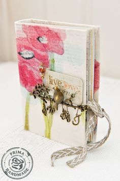 mini album made using 12x12 canvas sheets by donna downey/prima