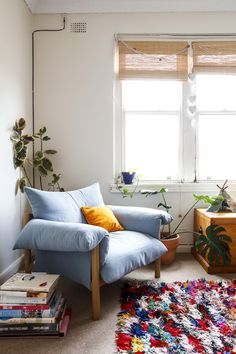 Cozy corner - oversized armchair, Moroccan rug, sunlight and plants galore.