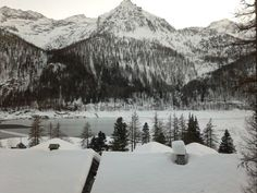 Winter panorama over the Alps, with about 1 m of snow on the ground (much less on the roofs, due to the blowing snow removed by the strong foehn winds). (Ceresole Reale, Alps, Italy)