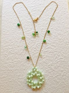 A personal favorite from my Etsy shop https://www.etsy.com/listing/235566524/cats-eye-necklace-pendant-necklace-green