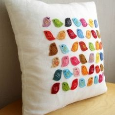So cute and colorful!!! Easy to felt/hand-sew onto a cheap Ikea throw pillow.