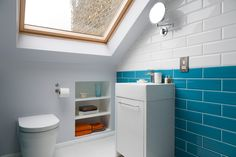 Loft conversion blue tiled bathroom with recessed storage