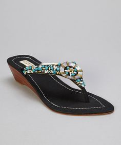 Take a look at this Black Circle Shell Thong Sandal by la pomme on #zulily today!