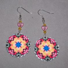 Dangle earrings adorned with my pink dahlia, blue hydrangea and pink Peruvian lily boho chic mandala new age sacred geometry hippie kaleidoscope design titled Deepest Devotion. <br /> <br />These lightweight, dainty silver earrings begin with a dangle of light topaz Swarovski crystal beads and a pink heart Swarovski crystal bead that accentuates the colors in the m...