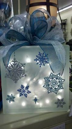Get your home ready for the Christmas season and all winter as we offer you some Creative Christmas Snowflake Decorating Ideas to make stunningly simple holiday accents. Diy Christmas Fireplace, Christmas Glass Blocks, Diy Christmas Snowflakes, Snowflake Decorations, Christmas Decorations, Blue Christmas Decor, Blue Christmas Lights, Fireplace Ideas, Painted Glass Blocks