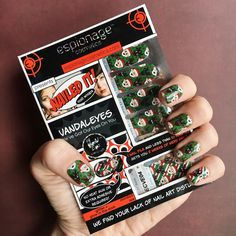 NEW for the holidays! Anne Wheaton and Bonnie Burton team up with Espionage Cosmetics for another round of googly-eyed fun with this set of jolly nail wraps! Of course, no VandalEyes nail wraps are complete without glow-in-the-dark features! Now taking pre-orders at the link! #EspionageCosmetics #VandalEyes #NerdManicure #NerdNails #HolidayNails #ChristmasNails #NailArt #Nailspiration #NerdNails #GooglyEyes