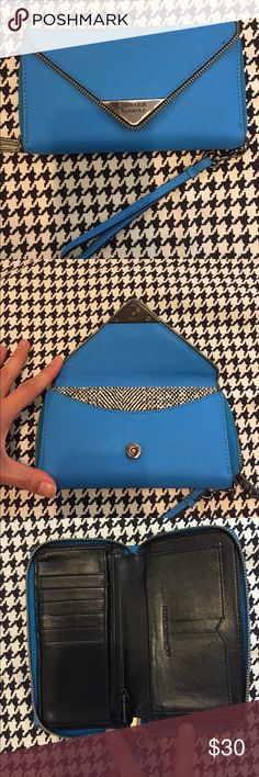 🌀Rebecca Minkoff wallet💠 Authentic Rebecca Minkoff wallet| Cobalt blue| Black leather interior| Used, but in great condition!| Sign of tarnish on the metal RB insignia as shown in the last pic Rebecca Minkoff Bags Wallets