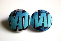 Large baby blue batman button earrings.