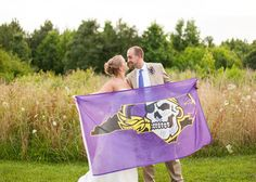 The couple from today's real wedding feature bleeds ECU purple and gold! They used this flag as their guest book, and had every wedding attendee sign it!