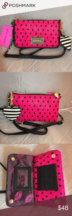 "Betsey Johnson Hot Leopard prints Crossbody wallet Measures 5""x 8"". It's roomy. Front: Magnetic snap closure. 3 credit card slots and 1 ID window. 1 bill slot. Back: Zipper pocket. Easily fits larger phone such as iPhone 6 Plus. The Black striped heart key chain is detachable. Betsey Johnson Bags Crossbody Bags"
