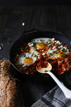 Shakshuka for two! Poached eggs in a tomato sauce warmed with cumin and smoked paprika sprinkled with feta cheese.