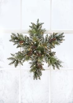 This bristle pine snowflake is sprinkled with glitter and features LED lights. HomeDecorators.com #holiday2015