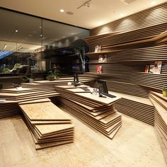 Kengo Kuma stacks wooden layers inside office and cafe pair