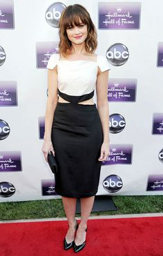 Actress Alexis Bledel looked lovely on the red carpet accessorizing with the Swarovski black satin Party Time clutch