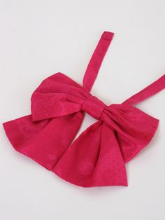 Pink Ladies Bow Tie: Replace your necklace with this super fun 1980s big bow neck tie!