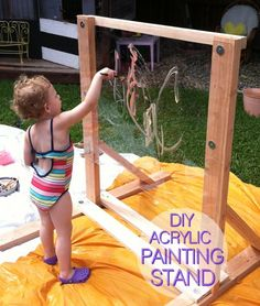 DIY Reggio Style Acrylic Painting Stand maybe make one to fit in the water table at work? Reggio Emilia, Natural Playground, Outdoor Playground, Playground Ideas, Outdoor Play Spaces, Outdoor Fun, Backyard For Kids, Outdoor Play For Toddlers, Backyard Play Areas
