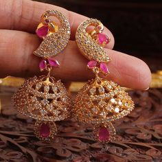 in love with these jhumkas Gold Jhumka Earrings, Gold Earrings Designs, Antique Earrings, Necklace Designs, Peacock Jewelry, Coral Jewelry, Wedding Jewelry, Indian Jewelry Sets, India Jewelry