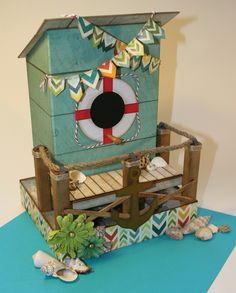 Laura Denison as Following the Paper Trail with her August 2013 Bird Abode construction and mini album
