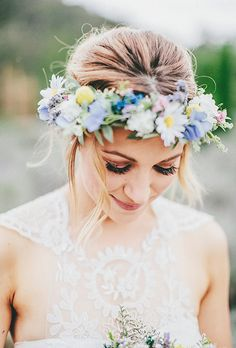 Lavender honeysuckles and bright daisies with magenta roses make a great flower crown | Brides.com
