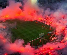 The Fans of PAOK Thessaloniki (Greece) create a ring of fire in their Toumba stadium with flairs known as Roman candles. Soccer Stadium, Soccer Fans, Football Stadiums, Football Soccer, Soccer Match, Football Field, Football Casuals, Escudo River Plate, Sc Internacional