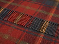 Traditional Tartan Throw Blanket.  Top Quality * British Made * Pure New Wool Great as a picnic blanket or for barbecues, beach, camping or sports events  Ideal as a furniture throw for any chair or sofa  Keeping you warm and cosy when reading or watching TV, or just napping!  Lovely warm all wool throw rugs perfect for any outdoor trip  The traditional car travel rug  Ideal Scottish gifts in your family tartan.  Measuring approx 140cm x 180cm with a rolled fringe. Weight approx 1kg…