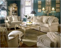 Scrumptious beige sofa and chairs  update this tradtional look.